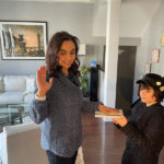 Skadden Fellow Ruby Kish with her son at her virtual swearing in.